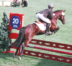Chelsea McNeil and Bein Mallin Rory O'Sullivan sailing over the jump in Jeopardy Jumping